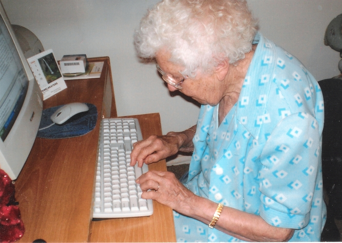Madeline Orlowski  Anderson typing her emails