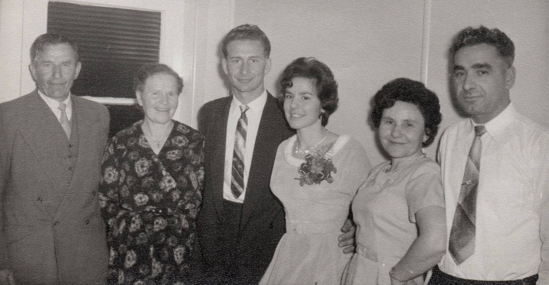 Black  and white pic of Zenona and Michał between their parents of either side. All are smiling and Zenona's mother has her hand of  her hip. Zenona and Emilja are in light-coloured dresses and Michał and his father in suits. Zofia is wearing a flowered  dress and Jozef Cyckoma has his jacket off.