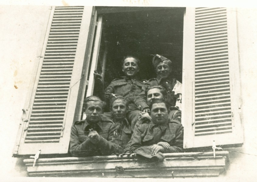 Polish  soldier students looking out of a window in Ascoli Picento