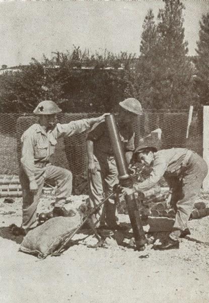 Władysław Piotrkowski operating the mortar