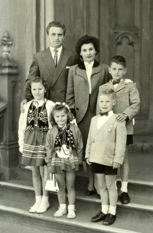Ginter and Ula Poczwa  with their four children on church steps