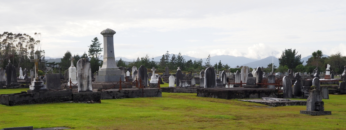 A wide shot of the Hokitika cemetery, showing the hills in the background
