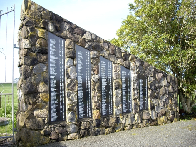 The triangular stone entrance at the Midhirst Old cemetery, showing five plaques of names, the plaques becoming smaller  the farther from the gate they are.
