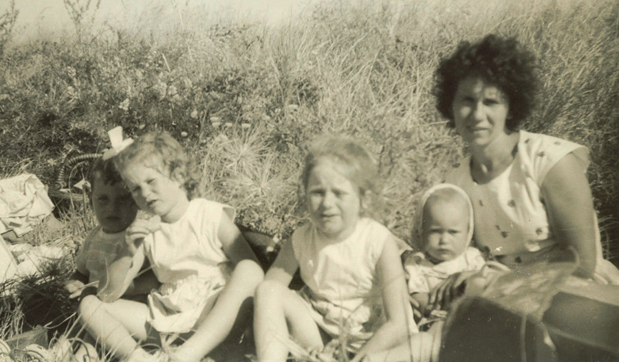 Stasia  with four children at Wainuiomata beach 1961