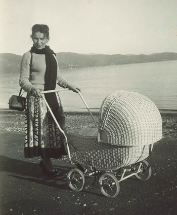 Stasia  pushing a pram in Petone
