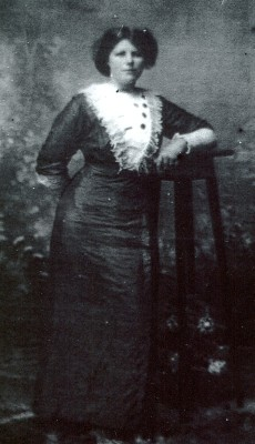 Ellen (Nell)  Cecelia Voitrekovsky as a young woman in a long dress